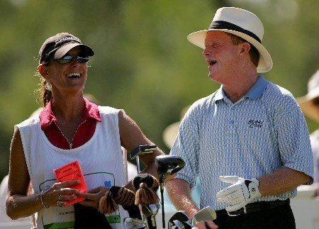 SAN ANTONIO - OCTOBER 21:  Tom Kite laugs with his caddie Sandy Jones during the final round of the AT&T Championship at Oak Hills Country Club on October 21, 2007 in San Antonio, Texas.  (Photo by S.Greenwood/Getty Images)
