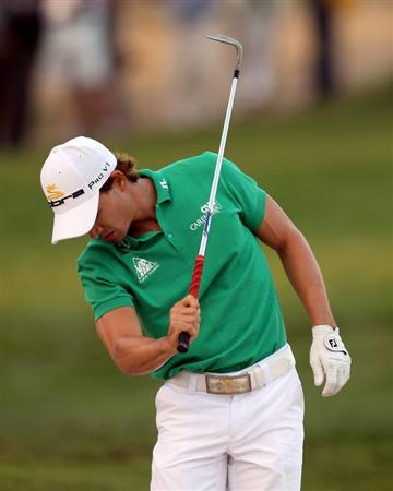 DOHA, QATAR - JANUARY 29:  Camilo Villegas of Colombia on the 18th hole during the second round of the Commercialbank Qatar Masters at the Doha Golf Club on January 29, 2010 in Doha, Qatar.  (Photo by Ross Kinnaird/Getty Images)