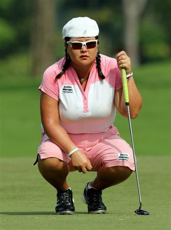 KUALA LUMPUR, MALAYSIA - OCTOBER 23: Christina Kim of USA lines up for a putt on the 3rd hole during Round Two of the Sime Darby LPGA on October 23, 2010 at the Kuala Lumpur Golf and Country Club in Kuala Lumpur, Malaysia. (Photo by Stanley Chou/Getty Images)