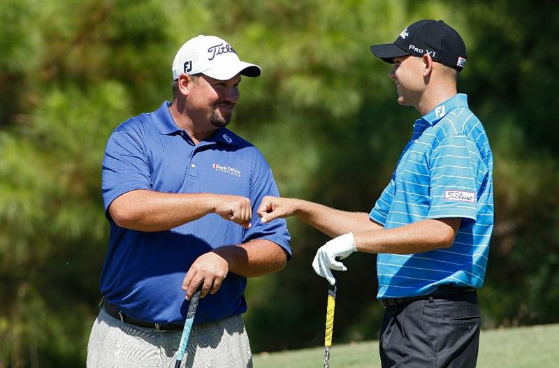 MADISON, MS - OCTOBER 02:  Brendon de Jonge of Zimbabwe (L) and Bill Haas bump fists on the fourth tee box during the third round of the Viking Classic held at Annandale Golf Club on October 2, 2010 in Madison, Mississippi.  (Photo by Michael Cohen/Getty Images)