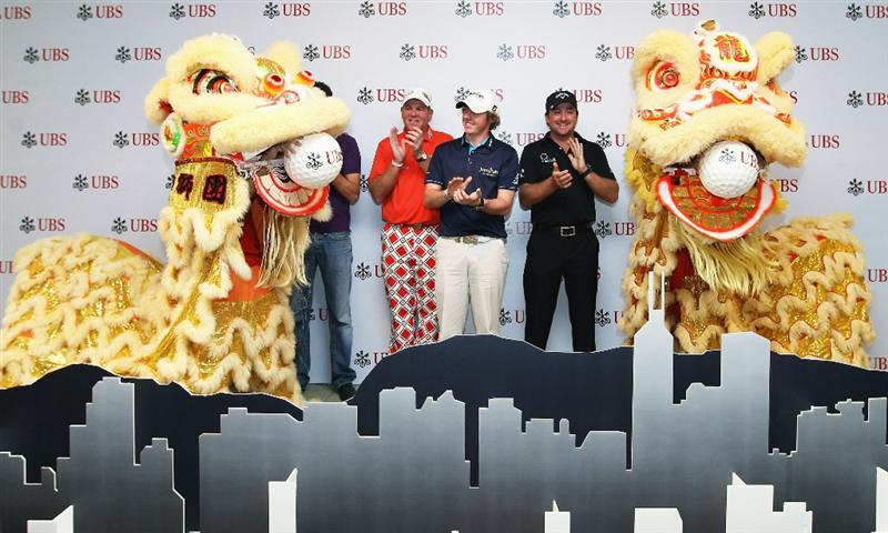 HONG KONG - NOVEMBER 16:  Graeme McDowell, Rory McIlroy of Northern Ireland and John Daly of the United States during the UBS Hong Kong Open Opening Ceremony at the International Finance Centre on November 16, 2010 in Hong Kong, Hong Kong.  (Photo by Ian Walton/Getty Images)