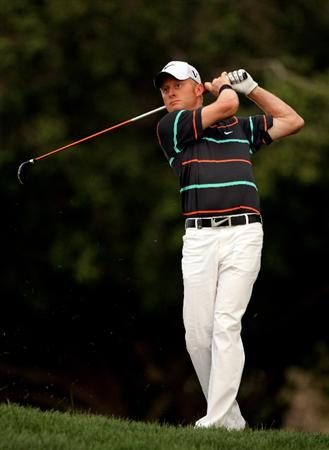 DUBAI, UNITED ARAB EMIRATES - FEBRUARY 04:  Simon Dyson of England hits his second shot on the tenth hole during the first round of the Omega Dubai Desert Classic on February 4, 2010 in Dubai, United Arab Emirates.  (Photo by Andrew Redington/Getty Images)