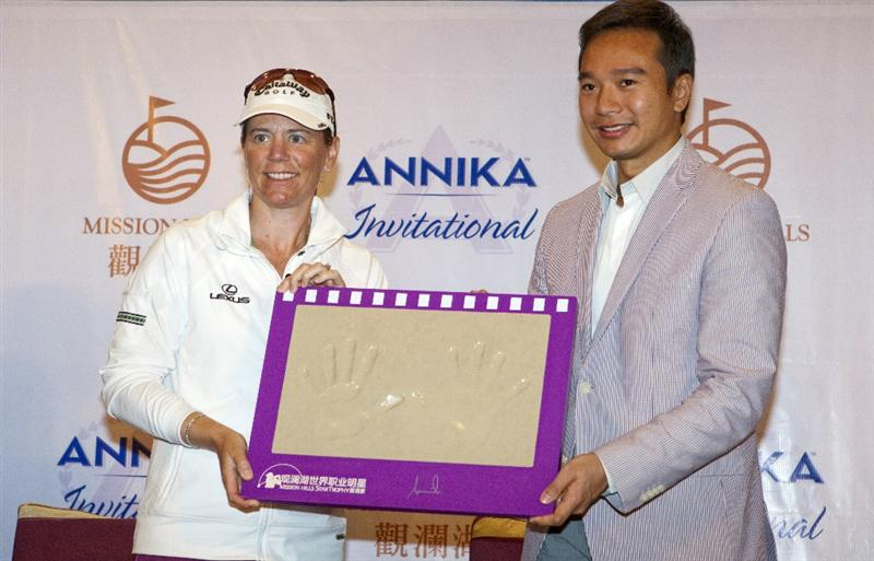 HAIKOU, CHINA - OCTOBER 29: (L-R) Golfer Annika Sorenstam of Sweden and  Executive Director Mission Hills Tenniel Chu pose with a handprint during a press conference as part of the Mission Hills Star Trophy tournament at Mission Hills Resort on October 29, 2010 in Haikou, China. The Mission Hills Star Trophy is Asia's leading leisure liflestyle event and features Hollywood celebrities and international golf stars.  (Photo by Athit Perawongmetha/Getty Images for Mission Hills)