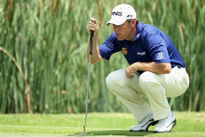 SUN CITY, SOUTH AFRICA - DECEMBER 01:  Lee Westwood of England lines up a putt on the 17th green during the pro-am for the 2010 Nedbank Golf Challenge at the Gary Player Country Club Course  on December 1, 2010 in Sun City, South Africa.  (Photo by Warren Little/Getty Images)