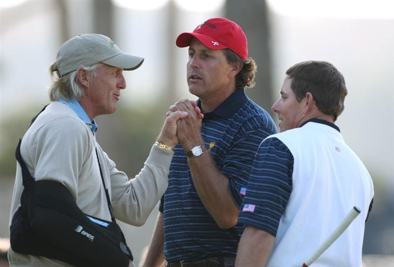 SAN FRANCISCO - OCTOBER 09:  Greg Norman, Captain of the International Team congratulates Phil Mickelson and Justin Leonard of the USA Team after winning their Day Two Fourball Match against Retief Goosen and Adam Scott for The Presidents Cup at Harding Park Golf Course on October 9, 2009 in San Francisco, California.  (Photo by Warren Little/Getty Images)