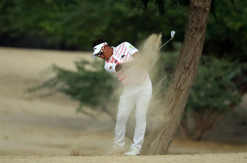 DUBAI, UNITED ARAB EMIRATES - FEBRUARY 07:  Thongchai Jaidee of Thailand plays his second shot at the 14th hole during the final round of the 2010 Omega Dubai Desert Classic on the Majilis Course at the Emirates Golf Club on February 7, 2010 in Dubai, United Arab Emirates.  (Photo by David Cannon/Getty Images)