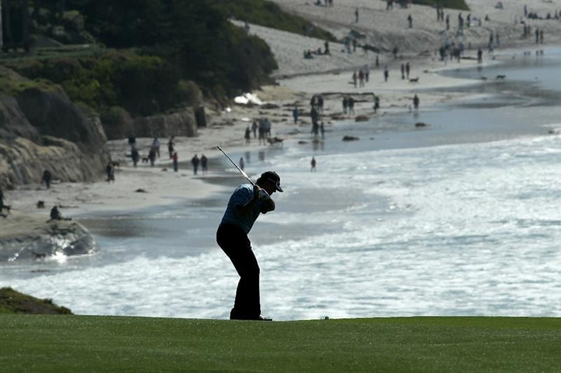 PEBBLE BEACH, CA - FEBRUARY 14:  Paul Goydos hits his second shot on the ninth hole during the final round of the AT&T Pebble Beach National Pro-Am at Pebble Beach Golf Links on February 14, 2010 in Pebble Beach, California.  (Photo by Stephen Dunn/Getty Images)