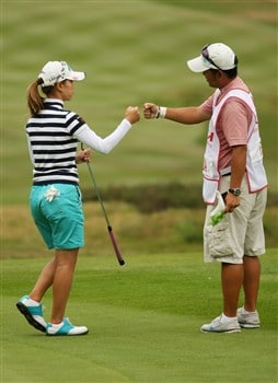 SUNNINGDALE, UNITED KINGDOM - JULY 31:  Momoko Ueda of Japan celebrates with her caddie after an eagle on the 10th green during the first round of the 2008 Ricoh Women's British Open held on the Old Course at Sunningdale Golf Club on July 31, 2008 in Sunningdale, England.  (Photo by Warren Little/Getty Images)