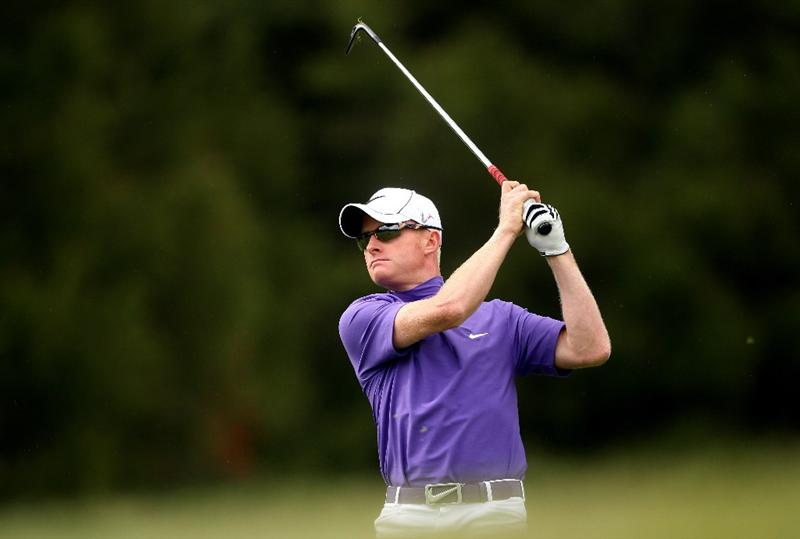 CRANS, SWITZERLAND - SEPTEMBER 03:  Simon Dyson of England hits his second shot on the 12th hole during the first round of The Omega European Masters at Crans-Sur-Sierre Golf Club on September 3, 2009 in Crans Montana, Switzerland.  (Photo by Andrew Redington/Getty Images)