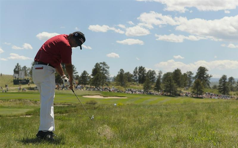 PARKER, CO. - MAY 30: Chien Soon Lu of Taiwan hits his approach shot into the 16th hole the during the fourth and final round of the Senior PGA Championship at the Colorado Golf Club on May 30, 2010 in Parker, Colorado.  (Photo by Marc Feldman/Getty Images)