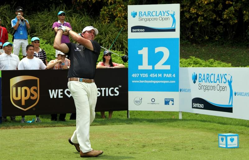 SINGAPORE - NOVEMBER 13: Phil  Mickelson of USA tees off on the 12th hole during the Third Round of the Barclays Singapore Open held at the Sentosa Golf Club on November 13, 2010 in Singapore, Singapore.  (Photo by Stanley Chou/Getty Images)