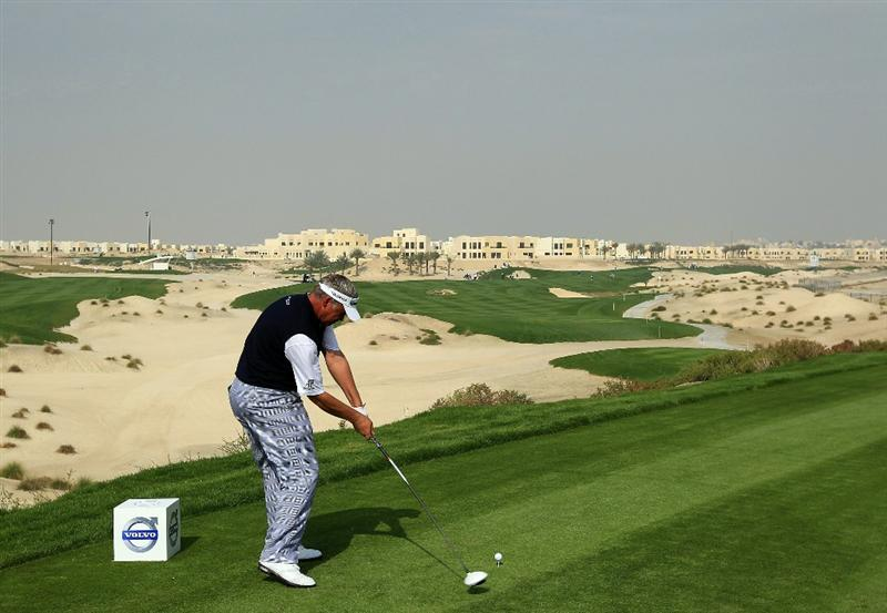 BAHRAIN, BAHRAIN - JANUARY 27:  Darren Clarke of Northern Ireland plays his tee shot at the 3rd hole during the first round of the 2011 Volvo Champions held at the Royal Golf Club on January 27, 2011 in Bahrain, Bahrain.  (Photo by David Cannon/Getty Images)