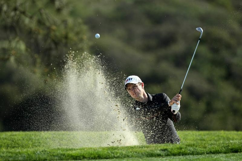 LA JOLLA, CA - JANUARY 26:  Justin Rose of Great Britain hits out of the bunker during the Pro-Am at the Farmers Insurance Open at Torrey Pines on January 26, 2011 in La Jolla, California. (Photo by Donald Miralle/Getty Images)