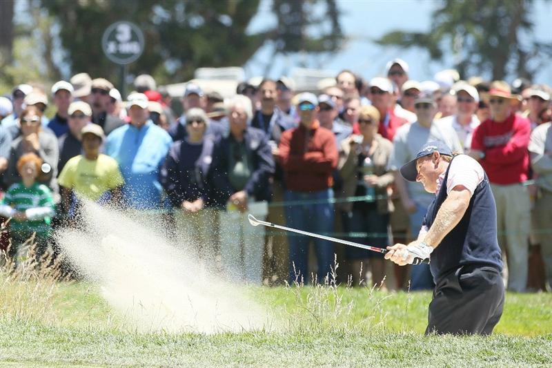 PEBBLE BEACH, CA - JUNE 17: Ernie Els of South Africa holes out from a bunker for eagle on the second hole  during the first round of the 110th U.S. Open at Pebble Beach Golf Links on June 17, 2010 in Pebble Beach, California.  (Photo by Jeff Gross/Getty Images)