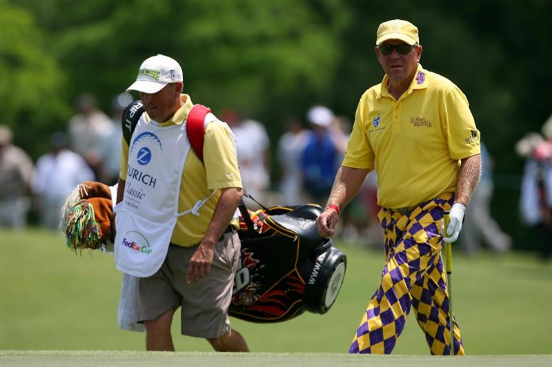AVONDALE, LA - APRIL 22:  John Daly tees walks on to the 13th green during the first round of the Zurich Classic at TPC Louisiana on April 22, 2010 in Avondale, Louisiana.  (Photo by Chris Trotman/Getty Images)