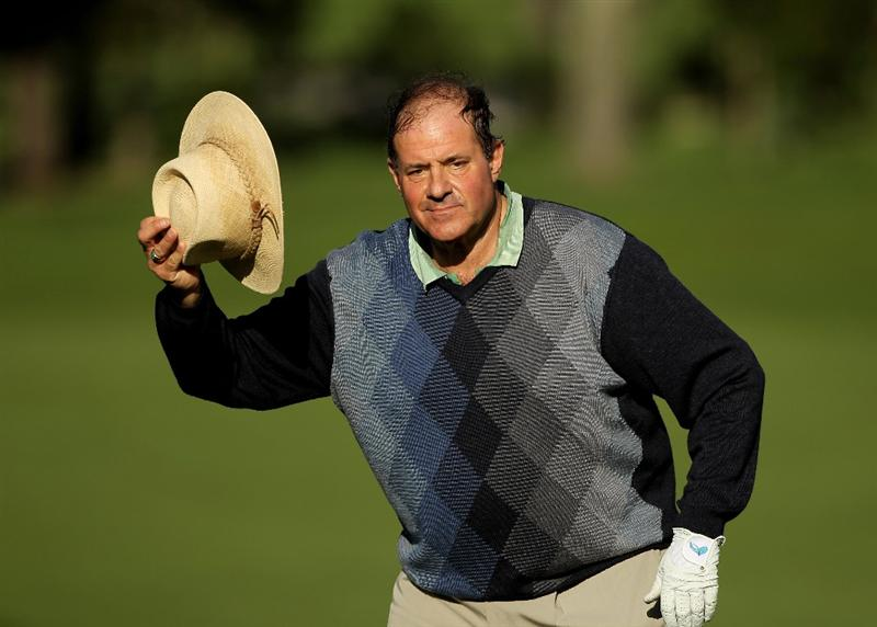 PEBBLE BEACH, CA - FEBRUARY 11:  Chris Berman tips his hat before finishing on the ninth hole during the first round of the AT&T Pebble Beach National Pro-Am at at the Spyglass Hill Golf Course on February 11, 2010 in Pebble Beach, California.  (Photo by Ezra Shaw/Getty Images)