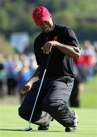 NEWPORT, WALES - OCTOBER 04:  Tiger Woods of the USA reacts to a putt in the singles matches during the 2010 Ryder Cup at the Celtic Manor Resort on October 4, 2010 in Newport, Wales.  (Photo by Jamie Squire/Getty Images)