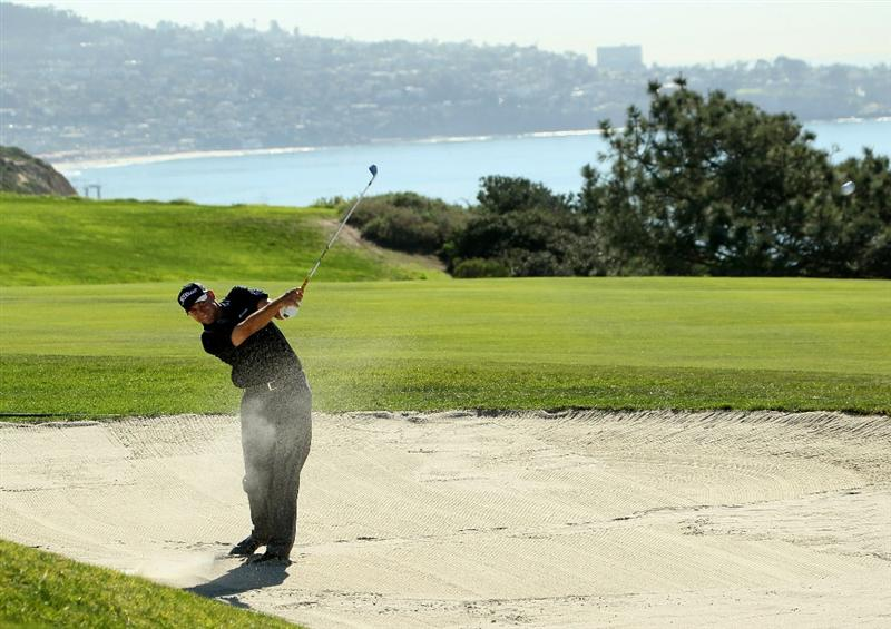 LA JOLLA, CA - JANUARY 28:  Bill Haas hits from a fairway bunker on the fourth hole during round two of the Farmers Insurance Open at Torrey Pines South Course on January 28, 2011 in La Jolla, California.  (Photo by Stephen Dunn/Getty Images)