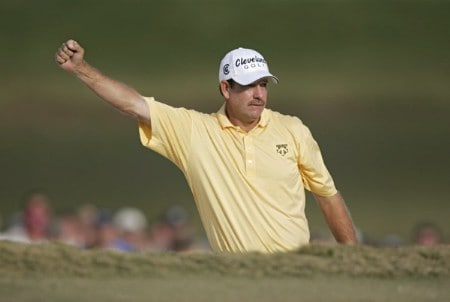 Bart Bryant celebrates after hitting out of a bunker on the 18th green and making a birdie during the third round of THE TOUR Championship at East Lake Golf Club in Atlanta, Georgia on November 5, 2005. Bryant finished the third round in the lead at -14.Photo by Hunter Martin/WireImage.com