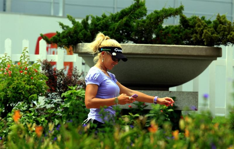 KUALA LUMPUR, MALAYSIA - OCTOBER 21:   Natalie Gulbis walks to the club house during the Sime Darby Pro-Am at the KLGCC Golf Course on October 21, 2010 in Kuala Lumpur, Malaysia (Photo by Stanley Chou/Getty Images)