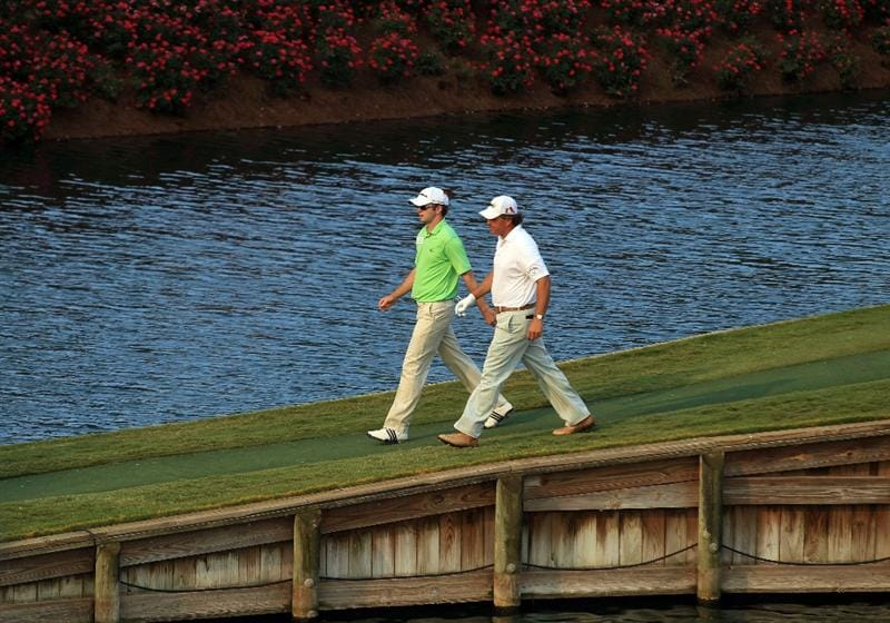 PONTE VEDRA BEACH, FL - MAY 12:  Phil Mickelson (R) and Martin Laird of Scotland (L) walk off the 17th green during the first round of THE PLAYERS Championship held at THE PLAYERS Stadium course at TPC Sawgrass on May 12, 2011 in Ponte Vedra Beach, Florida.  (Photo by Streeter Lecka/Getty Images)