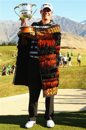 QUEENSTOWN, NEW ZEALAND - MARCH 15:  Alex Prugh of the USA is all smiles as he holds the winners trophy during day four of the New Zealand Men's Open Championship at The Hills Golf Club on March 15, 2009 in Queenstown, New Zealand.  (Photo by Phil Walter/Getty Images)