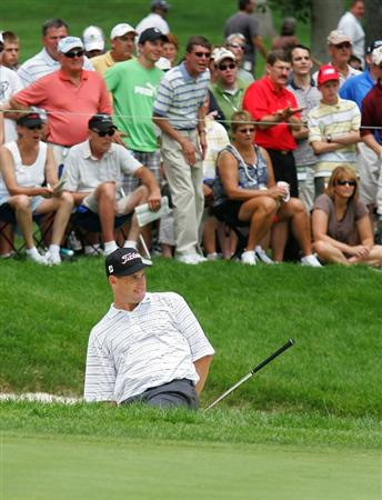 SILVIS, IL - JULY 12:  Darron Stiles of the USA reacts to nearly holing out for birdie on the 16th hole during the third round of the John Deere Classic at TPC Deere Run held on July 12, 2009 in Silvis, Illinois.  (Photo by Michael Cohen/Getty Images)