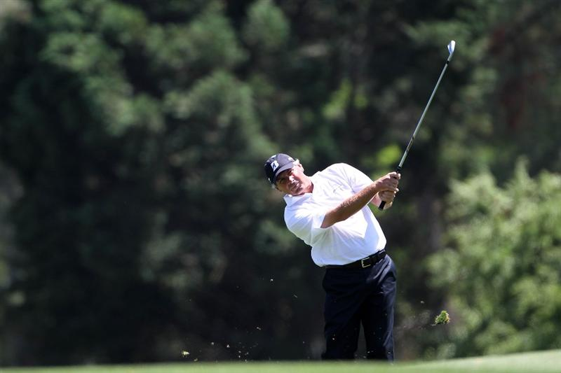 AUGUSTA, GA - APRIL 09:  Fred Couples hits a shot on the 14th hole during the second round of the 2010 Masters Tournament at Augusta National Golf Club on April 9, 2010 in Augusta, Georgia.  (Photo by Jamie Squire/Getty Images)