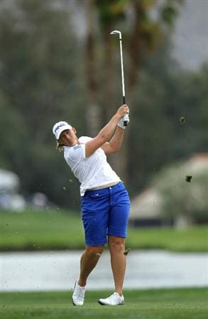 RANCHO MIRAGE, CA - APRIL 02:  Angela Stanford hits her third shot on the 18th hole during the third round of the Kraft Nabisco Championship at Mission Hills Country Club on April 2, 2011 in Rancho Mirage, California.  (Photo by Stephen Dunn/Getty Images)