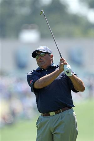 AUGUSTA, GA - APRIL 07:  Angel Cabrera of Argentina hits an approach shot on the first hole during the first round of the 2011 Masters Tournament at Augusta National Golf Club on April 7, 2011 in Augusta, Georgia.  (Photo by Andrew Redington/Getty Images)
