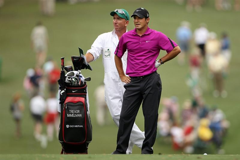 AUGUSTA, GA - APRIL 08:  Trevor Immelman of South Africa (R) looks on from the first fairway with caddie Michael Doran during the first round of the 2010 Masters Tournament at Augusta National Golf Club on April 8, 2010 in Augusta, Georgia.  (Photo by Andrew Redington/Getty Images)