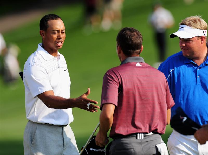AKRON, OH - AUGUST 06:  Tiger Woods of the U.S. shakes hands with Sergio Garcia of Spain on the 18th hole during the first round of the World Golf Championship Bridgestone Invitational on August 6, 2009 at Firestone Country Club in Akron, Ohio.  (Photo by Stuart Franklin/Getty Images)