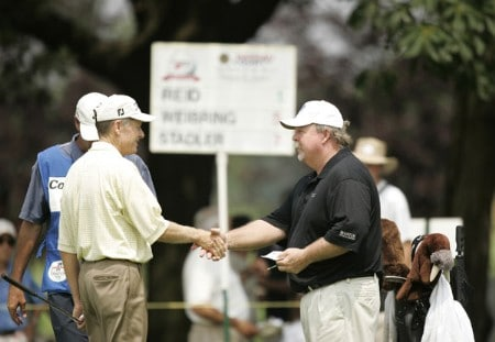 Craig Stadler shakes hands with Mike Reid on the 18th hole during the first round of the Commerce Bank Championship being held at the Eisenhower Park Red Course in East Meadow, New York on Friday July 1, 2005.Photo by Mike Ehrmann/WireImage.com