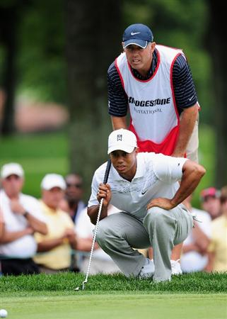 AKRON, OH - AUGUST 06:  Tiger Woods of USA and caddie Steve Williams line up his putt on the second hole during the first round of the World Golf Championship Bridgestone Invitational on August 6, 2009 at Firestone Country Club in Akron, Ohio.  (Photo by Stuart Franklin/Getty Images)