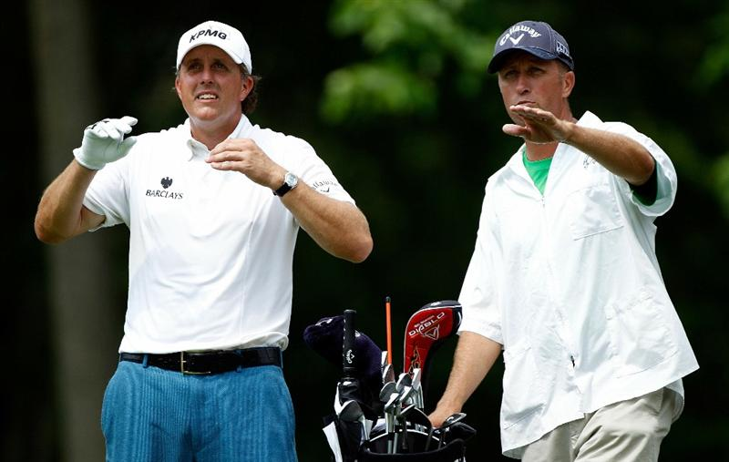 DUBLIN, OH - JUNE 04:  Phil Mickelson chats with his caddie Jim Mackay on the eighth hole during the second round of the Memorial Tournament presented by Morgan Stanley at Muirfield Village Golf Club on June 4, 2010 in Dublin, Ohio.  (Photo by Scott Halleran/Getty Images)