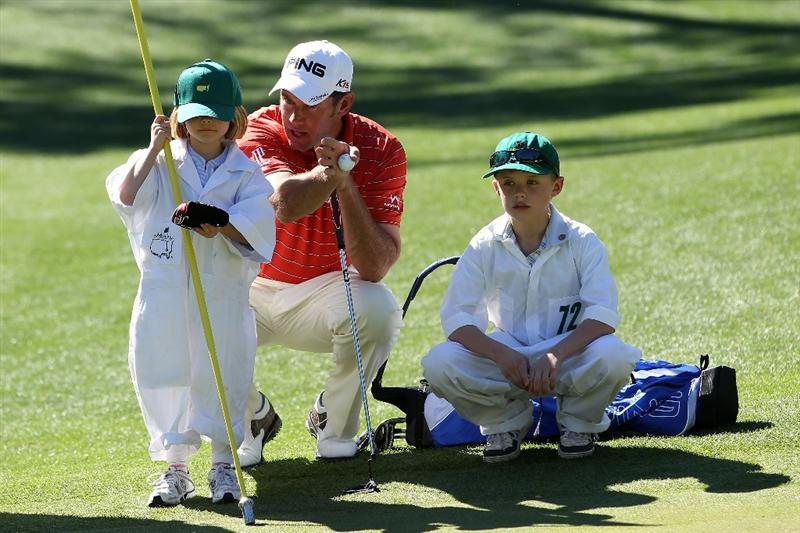 AUGUSTA, GA - APRIL 06:  Lee Westwood of England talks with his son Sam and daughter Poppy during the Par 3 Contest prior to the 2011 Masters Tournament at Augusta National Golf Club on April 6, 2011 in Augusta, Georgia.  (Photo by Andrew Redington/Getty Images)