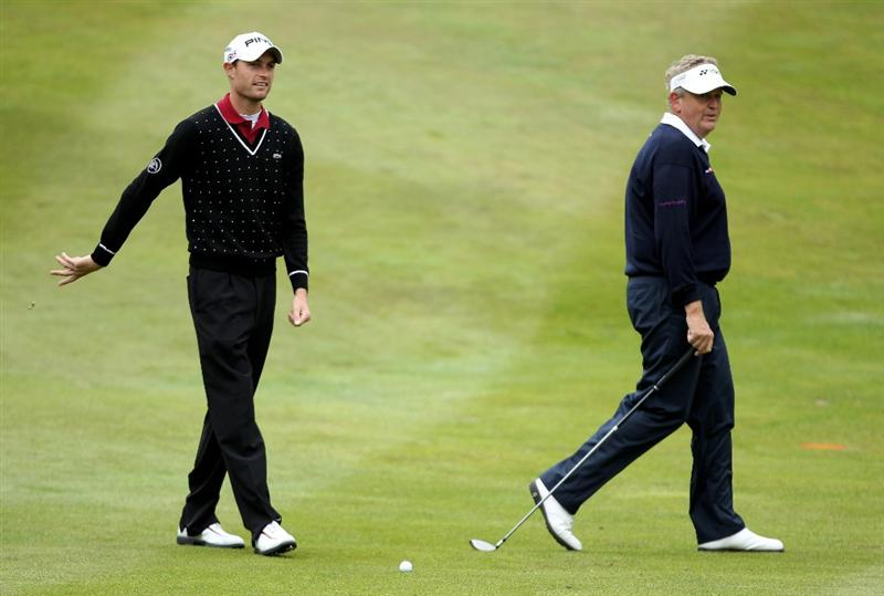 VIRGINIA WATER, ENGLAND - MAY 28:  Colin Montgomerie of Scotland looks on with Rhys Davies of Wales (L) during the third round of the BMW PGA Championship at the Wentworth Club on May 28, 2011 in Virginia Water, England.  (Photo by Ian Walton/Getty Images)
