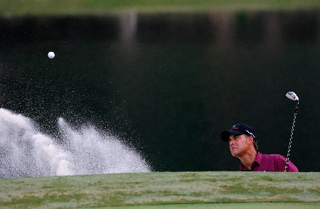 GREENSBORO, NC - AUGUST 17:  Scott McCarron blasts out of the sand onto the 15th green during the final round of the 2008 Wyndham Championship at Sedgefield Country Club on August 17, 2008 in Greensboro, North Carolina.  (Photo by Kevin C. Cox/Getty Images)