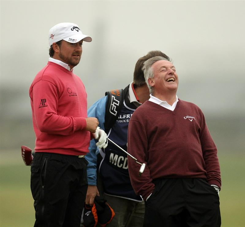 ST ANDREWS, SCOTLAND - OCTOBER 08:  Graeme McDowell of Northern Ireland with his father and playing partner Kenny McDowell on the 17th green during the second round of The Alfred Dunhill Links Championship at The Old Course on October 8, 2010 in St Andrews, Scotland.  (Photo by Ross Kinnaird/Getty Images)