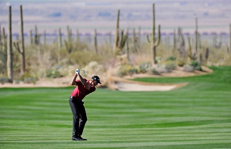 MARANA, AZ - FEBRUARY 16:  Geoff Ogilvy of Australia hits a shot during the second practice round prior to the start of the Accenture Match Play Championship at the Ritz-Carlton Golf Club on February 16, 2010 in Marana, Arizona.  (Photo by Stuart Franklin/Getty Images)