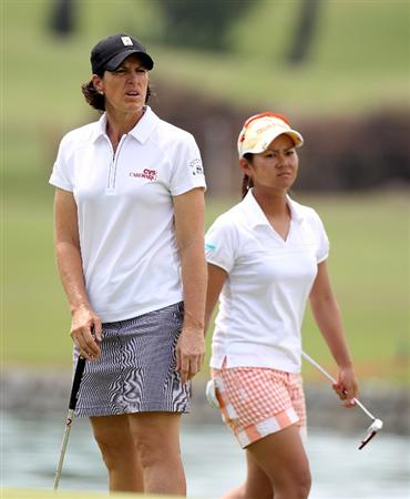 SINGAPORE - FEBRUARY 28:  Juli Inkster of the USA and Ai Miyazato of Japan during the final round of the HSBC Women's Champions at the Tanah Merah Country Club on February 28, 2010 in Singapore.  (Photo by Ross Kinnaird/Getty Images)
