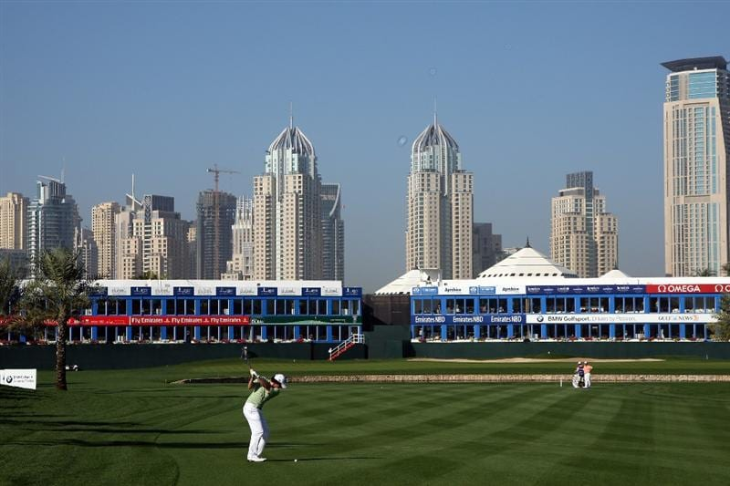 DUBAI, UNITED ARAB EMIRATES - FEBRUARY 01:  Rory McIlroy of Northern Ireland plays his second shot at the 18th hole during the completion of the third round of the 2009 Dubai Desert Classic on the Majilis Course at the Emirates Golf Club on February 1, 2009 in Dubai, United Arab Emirates  (Photo by David Cannon/Getty Images)