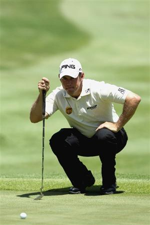 SUN CITY, SOUTH AFRICA - DECEMBER 05:  Lee Westwood of England lines up a putt during the final round of the 2010 Nedbank Golf Challenge at the Gary Player Country Club Course on December 5, 2010 in Sun City, South Africa.  (Photo by Luke Walker / Gallo Images / Getty Images)