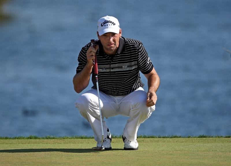 VILAMOURA, PORTUGAL - OCTOBER 17:  Oliver Wilson of England lines up his par putt on the 18th hole during the third round of the Portugal Masters at the Oceanico Victoria Golf Course on October 17, 2009 in Vilamoura, Portugal.  (Photo by Andrew Redington/Getty Images)