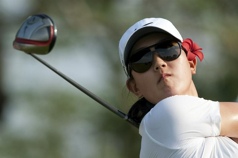 CHON BURI, THAILAND - FEBRUARY 18:  Michelle Wie of USA tees off on the 18th hole during day two of the LPGA Thailand at Siam Country Club on February 18, 2011 in Chon Buri, Thailand.  (Photo by Victor Fraile/Getty Images)