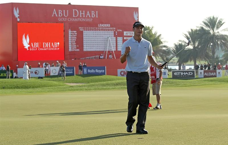 ABU DHABI, UNITED ARAB EMIRATES - JANUARY 24:  Martin Kaymer of Germany celebrates on the 18th green after winning The Abu Dhabi Golf Championship at Abu Dhabi Golf Club on January 24, 2010 in Abu Dhabi, United Arab Emirates.  (Photo by Andrew Redington/Getty Images)