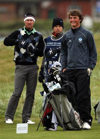 CARNOUSTIE, SCOTLAND - OCTOBER 02:  Magnus Carlsson of Sweden (L) and Ian Redford, Scottish Junior golfer, wait on the 17th hole during the second round of The Alfred Dunhill Links Championship at Carnoustie Golf Club on October 2, 2009 in Carnoustie, Scotland.  (Photo by Andrew Redington/Getty Images)