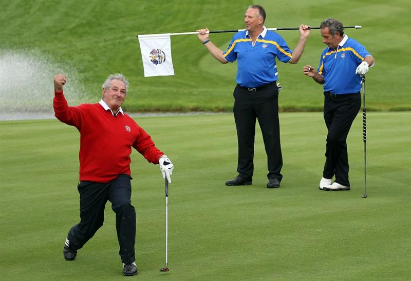 NEWPORT, WALES - SEPTEMBER 29:  Gareth Edwards celebrates holing a putt as Sir Ian Botham and Sam Torrance look on during a Past Captains round prior to the 2010 Ryder Cup at the Celtic Manor Resort on September 29, 2010 in Newport, Wales.  (Photo by Jamie Squire/Getty Images)