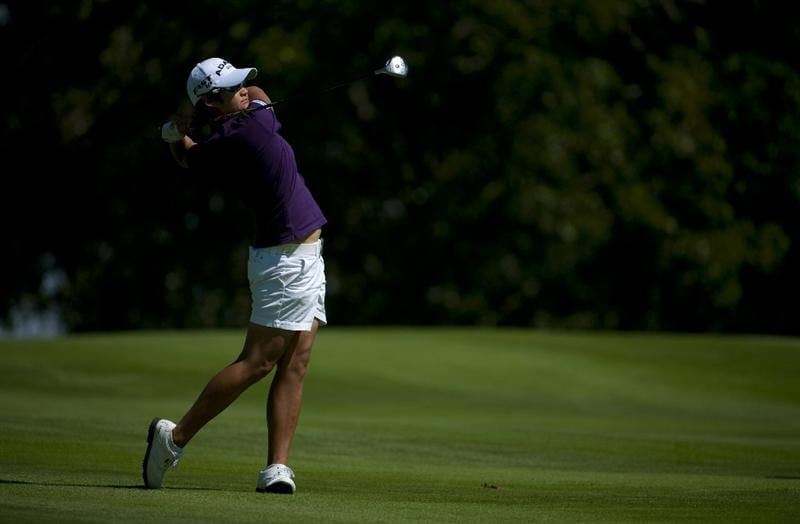 ROGERS, AR - SEPTEMBER 11:  Yani Tseng of Taiwan makes an approach shot on the 18th hole during the second round of the P&G NW Arkansas Championship at the Pinnacle Country Club on September 11, 2010 in Rogers, Arkansas.  (Photo by Robert Laberge/Getty Images)