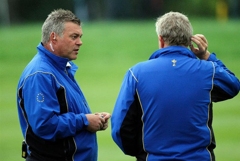 NEWPORT, WALES - SEPTEMBER 28:  Europe Team Captain Colin Montgomerie chats with Assistant Darren Clarke (L) during a practice round prior to the 2010 Ryder Cup at the Celtic Manor Resort on September 28, 2010 in Newport, Wales.  (Photo by Sam Greenwood/Getty Images)